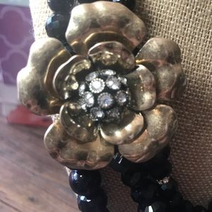 Chloe + Isabel Jewelry - Black beaded three row necklace with flower brooch